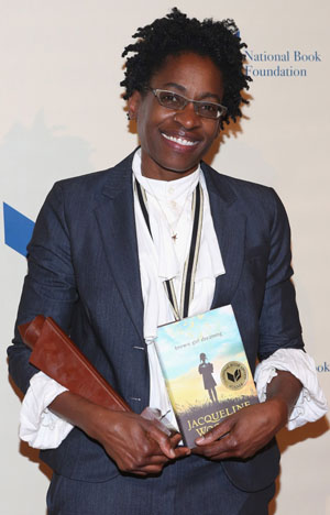 Author Jacqueline Woodson with her National Book Award for BROWN GIRL DREAMING